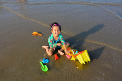 Asia kid play toy  sand sea sun funny Royalty Free Stock Photo