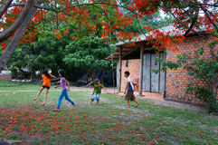 Asia kid, summertime, Vietnamese children. BA RIA- VIET NAM- JUNE16: Group of Asia kid playing at courtyard of house, outdoor activity on summertime, red summer stock photo