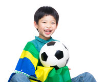 Asia little boy with brazil flag and soccer ball Royalty Free Stock Photography