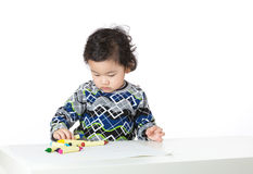 Asia little boy concentrate on drawing. Isolated on white Stock Photography