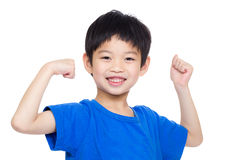 Asia little boy flexing biceps Royalty Free Stock Images
