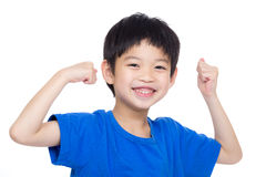 Asia little boy flexing biceps Royalty Free Stock Image