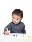 Asia little boy focus on drawing Stock Image