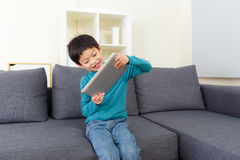 Asia little boy play tablet stock photography