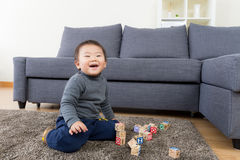Asia little boy play wooden toy block Stock Image