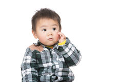 Asia little boy touch his face Royalty Free Stock Images