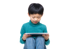 Asia little boy using tablet Royalty Free Stock Images