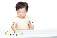 Asia little girl concentrate on drawing Stock Photos