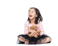 Asia little girl with doll bear Royalty Free Stock Photos