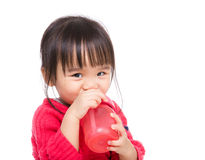 Asia little girl drinking water bottle. Isolated on white Stock Photography