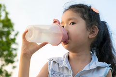 Asia little girl drinkink water Stock Photography