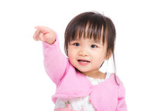 Asia little girl finger pointing to front stock photography