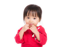 Asia little girl finger touch her lip Stock Photography
