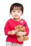 Asia little girl with her doll Royalty Free Stock Photos