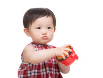 Asia little girl holding food box Stock Image