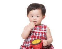 Asia little girl holding her food box Royalty Free Stock Photos