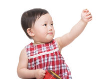 Asia little girl holding her snack box and hand up. Isolated on white Stock Photos