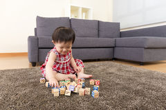 Asia little girl playing toy block Stock Images
