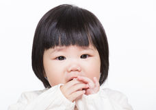 Asia little girl suck finger stock photo