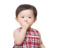 Asia little girl suck finger Royalty Free Stock Photo