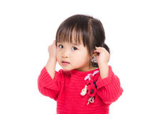 Asia little girl touch her ear Stock Images