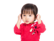 Asia little girl touch her ear Royalty Free Stock Image