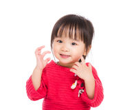 Asia little girl touch her face Royalty Free Stock Image