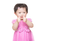 Asia little girl with two finger touch together stock photography