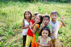 Asia lovely children (kids). KHANH HOA, VIET NAM- FEB 16: Unidentified Asia children in countryside, kids have pretty, lovely, pure face standing on meadow and royalty free stock images