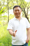 Asia man. Smiling Asian man in the park Royalty Free Stock Images