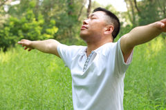 Asia man. Asian man in the park meditation Royalty Free Stock Photo