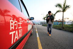 Asia man going to take taxi Royalty Free Stock Photography