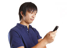 Asia man looking at mobile Royalty Free Stock Image
