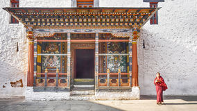 The asia man monk walks near the main door tower prayer at Paro Dzong, Royalty Free Stock Photography