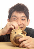 Asia man with piggy bank Royalty Free Stock Photo