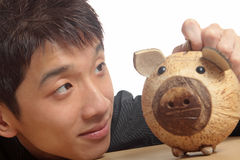 Asia man with piggy bank Royalty Free Stock Image