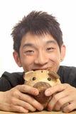 Asia man with piggy bank Royalty Free Stock Photos