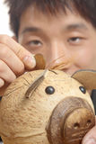Asia man with piggy bank Royalty Free Stock Images