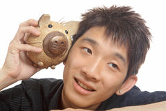 Asia man with piggy bank Stock Photo