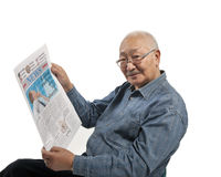 Asia man reads newspaper Royalty Free Stock Images