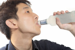 Asia man takes drink Royalty Free Stock Image