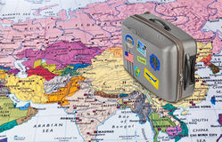 Asia map and travel case with stickers (my photos). Asia map and case with stickers (my photos) - travel background stock photo