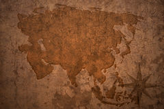 Asia map on vintage crack background. Asia map on a old vintage crack paper background stock photos