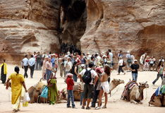 ASIA MIDDLE EAST JORDAN PETRA. Tourists in the Bab as Siq valley in the Temple city of Petra in Jordan in the middle east Stock Image