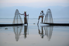 ASIA MYANMAR INLE LAKE. Fishermen at sunrise in the Landscape on the Inle Lake in the Shan State in the east of Myanmar in Southeastasia Royalty Free Stock Image