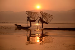 ASIA MYANMAR INLE LAKE. Fishermen at sunrise in the Landscape on the Inle Lake in the Shan State in the east of Myanmar in Southeastasia Stock Image
