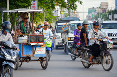 Asia, Myanmar: Motorbike traffic at an intersection in Mandalay royalty free stock photos