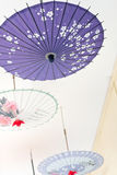 Asia Oil-paper umbrella. Oil-paper umbrella is a kind of paper umbrella originated in China Stock Photo