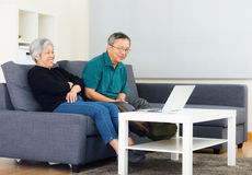 Asia old couple watching on computer Stock Photography