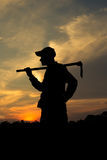 Asia,Old farmer and sunset Royalty Free Stock Image